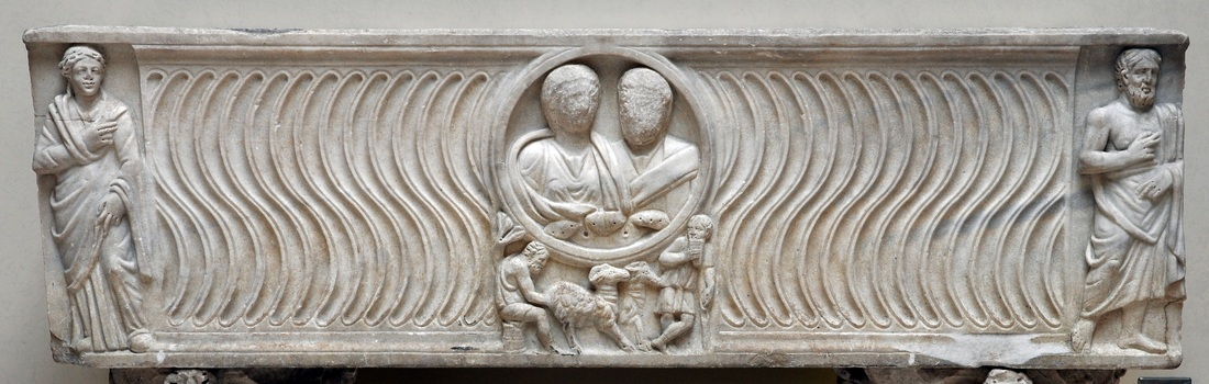Roman strigillated sarcophagus with portrait of a couple; bucolic scene under clipeus, and philosopher & muse at ends. Third century AD. Rome, Capitoline Museum (inv. MC813).